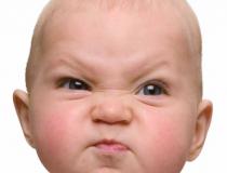 baby scrunching face